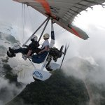 Flying with the angels: Chris enjoys a fresh-air view of Victoria Falls by microlight
