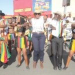 STREET CARNIVAL! Minister of Tourism and Arts Sylvia Masebo, centre, with Zimbabwean Orchestra Dendra Kings, Chipawo Dance Ensemble and Zimbabwe Wonders Team exude carvinal stunts during the official flag of the Cultural and Arts Festival in Livingstone recently.