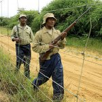 Mmopi Tebogelo, right, and fellow ranger Gabriel Mpiping on patrol at the Khama Rhino Sanctuary. © Mike Pflanz