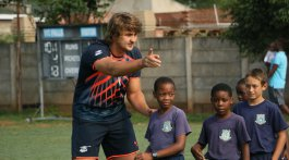 Springbok and Free State Cheetahs lock Lodewyk de Jager coaching Victoria Falls Primary School children at the rugby clinic