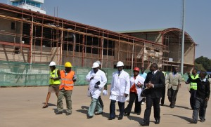 HARRY Mwaanga Nkumbula International Airport manager Joseph Mumbi (right, front row in black suit) taking Livingstone member of Parliament Howard Sikwela (second from right, front) around the new terminal building under construction. - Picture by CHARLES CHISALA.