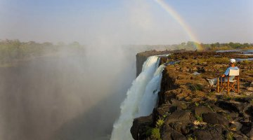 Sitting on a chair above Victoria Falls