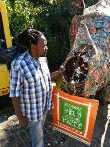Gift the Ruoko Artist showing Twalumba Poached horn.