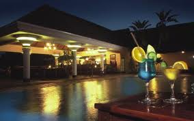 Ilala Lodge at night around the swimming pool