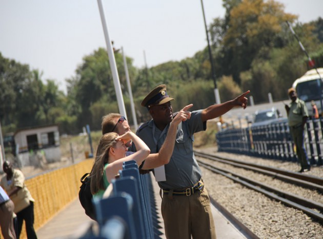 A Police officer gives tourists directions