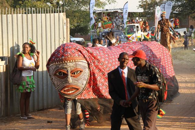 A chongololo making its way into Chinotimba stadium during a street carnival.