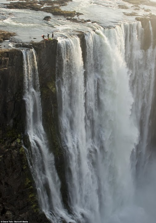 Steve Fisher, 37, Dale Jardine, 33, both from South Africa, and Sam Drevo, 33, from the U.S., paddled up to the lip of the mile-wide Victoria Falls - the largest waterfall in the world Read more: http://www.dailymail.co.uk/news/article-2148041/Daredevil-kayakers-paddle-precipice-Victoria-Falls--just-better-look.html#ixzz2cVMxkraB  Follow us: @MailOnline on Twitter | DailyMail on Facebook