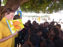 Reading a book to the children at Dambwa Primary School