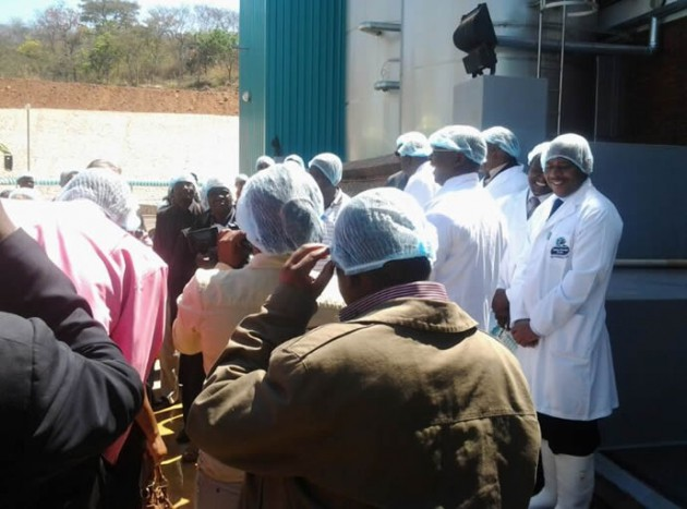Delegates being briefed on the milk factory and staff