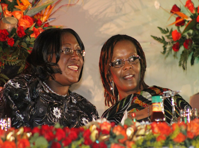 First Ladies Amai Grace Mugabe and Christine Kasebo Sata follow proceedings at the UNWTO General Assembly 20th Session official closing in Livingstone, Zambia