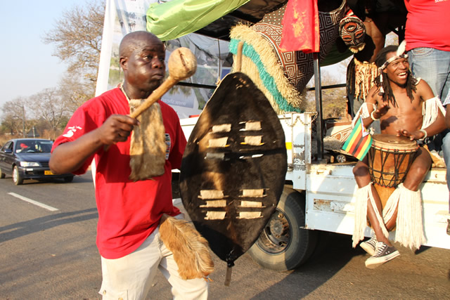 Lovemore Moyo member of the Horn of Africa group perform during a street carnival in Victoria Falls.