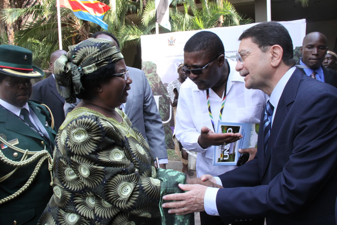 Malawian President Mrs Joyce Banda being introduced to UNWTO Secretary General Mr Taleb Rifai by Tourism and Hospitality Industry Minister Engineer Walter Mzembi at Elephant Hills Hotel in Victoria Falls