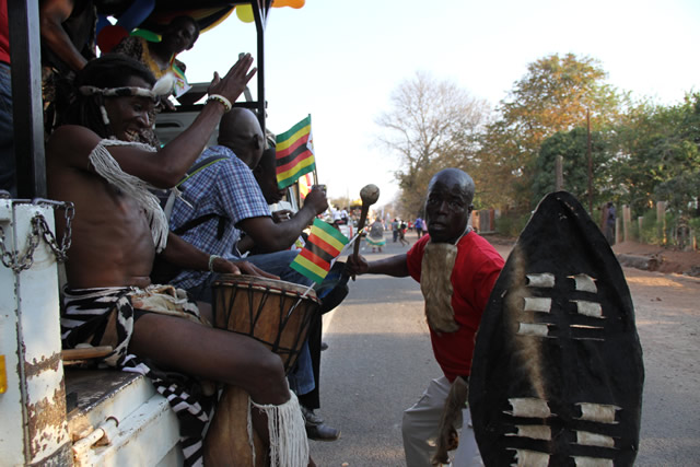 Members of Horn o Africa group perform during a street carnival in Victoria Falls