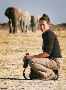 One of the journalists while in Eotsha National Park with the elephants approaching from behind her