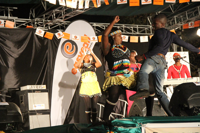 Sandra dances Muchongoyo with a fan during the UNWTO tourism night musical gala at Victoria Falls Primary School