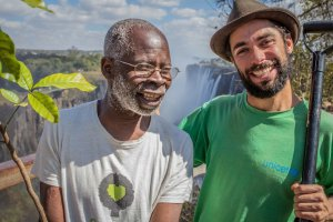 Benjamin Mibenge (Uncle Ben) Greenpop's Director of Trees Zambia and Misha Teasdale, Greenpop's co-founder and director at the mighty Victoria Falls after planting trees there.