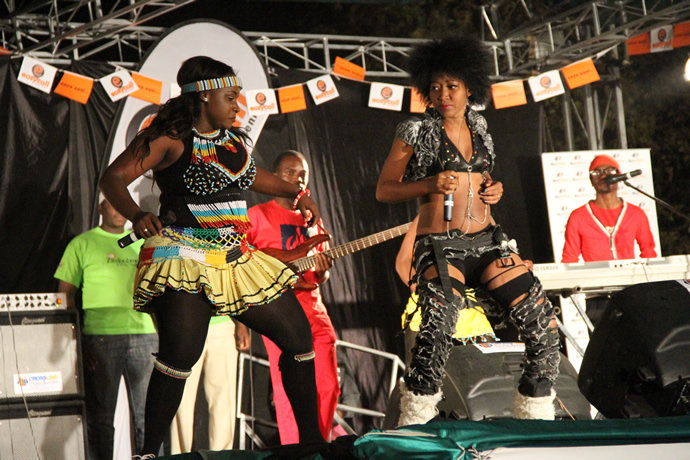 Slizer shares stage with Sandra Ndebele during the UNWTO tourism night musical gala at Victoria Falls Primary School