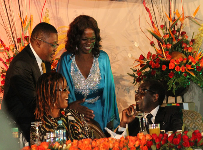 Tourism Ministers Engineer Walter Mzembi and Sylvia Masebo congratulate President Mugabe for a poetic speech at the closing ceremony of the UNWTO General Assembly 20th Session