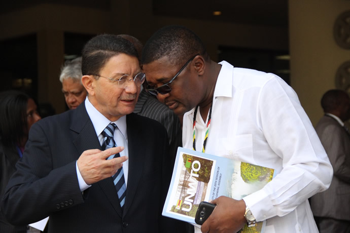 Tourism and Hospitality Minister Engineer Walter Mzembi chats with UNWTO Secretary General Mr Taleb Rifai