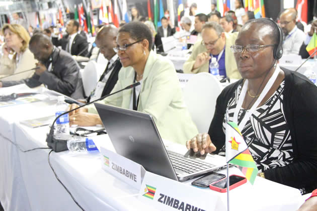 Tourism and Hospitality Permanent Secretary Magaret Mukahanana follow proceedings during the 20th session of the UNWTO General Assembly at Livingstone hotel, Zambia