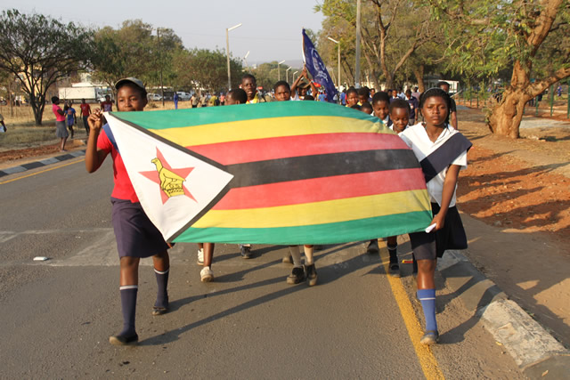 Victoria falls boy scouts and girl guides during a street carnival along Livingstone way in Victoria Falls