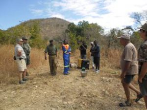 Waiting with Geni , extensions, water etc.  for the call that the Elephant is darted and down