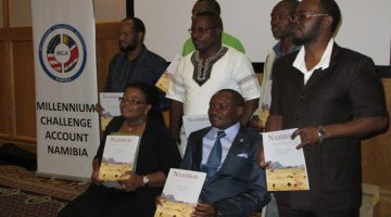 NACSO Director Maxi Louis and Deputy Minister of Environment and Tourism, Pohamba Shifeta [sitting], together with Conservancy Chairpersons Elias Kharuxab (representing South), Dave Kangombe (representing North-West), Marama Kavita (representing Central), Francis Lisao (representing North-East) and MET Tourism Director Sem Shikongo [from left to right]
