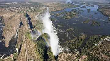 The almighty Victoria Falls with Victoria Falls Resort town at the top left of the picture