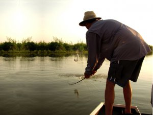 Henry and his team mates reel in Tiger fish
