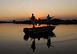 Fishing on the Zambezi River as the sun goes down