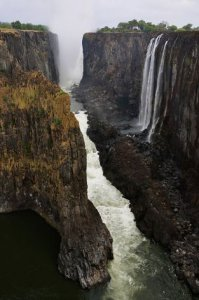 Victoria Falls, on the border between Zambia and Zimbabwe, is more than 5,000 feet wide and 300 feet tall, making it the world's greatest sheet of falling water. Photo: Mark Sissons, Special To The Chronicle