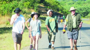 •DAVID Lemon (right) joined by well-wishers among them Zambian artist Alexis Phiri at the start of his second leg Zambezi Cowbell Trek in Siavonga last month. Picture Courtesy of Promasidor