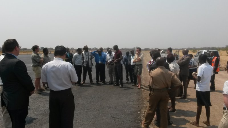 Engineers explaining the construction of the 4 km runway, and its capacity