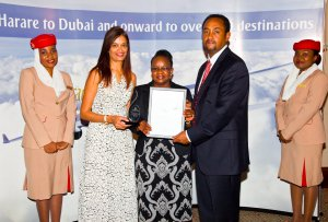 Emirates Country Manager for Zimbabwe Paulos Legesse presents the award for Business Class Top Sales and Travel Agency Second Runner-up to Star Travel