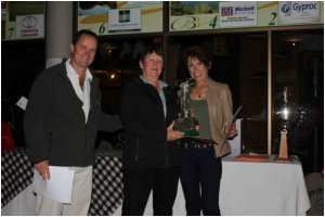 The first ever female winners of the annual Golf Day fundraiser for VFAPU (left) Fi Ranby and (right) Linda O'Toole receive their trophy from Africa Albida Tourism financial director Nigel Frost, who hosted the day.