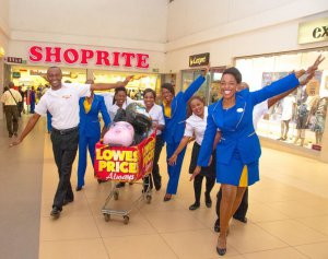 Proflight Zambia and Shoprite staff celebrate their ticket sale