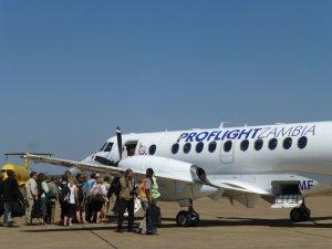 Tourists board one of Proflight Zambia's Jetsream 41 aircraft