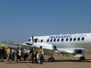 Tourists board one of Proflight Zambia's Jetsream 41 aircraft