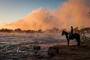 Well known horse woman, Alison Baker, looking out onto the Zambezi River
