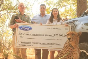 Sylvester Cheetah Ambassador with VFWT Wildlife Manager Roger Parry, Gen.Manager Jessica Dawson with Dulys Bill Cornish handing over the (1)